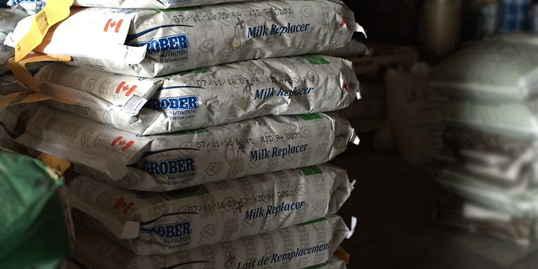 Grober milk replacer stacked on pallet in storage